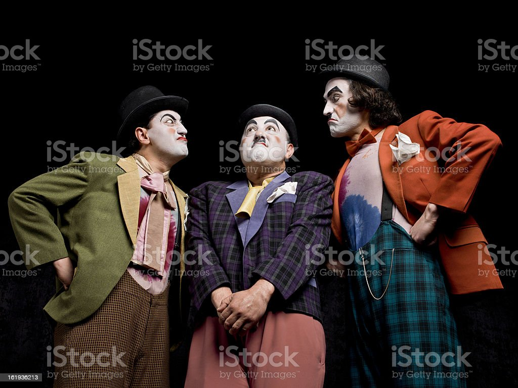 Three male mimes on the stage stock photo