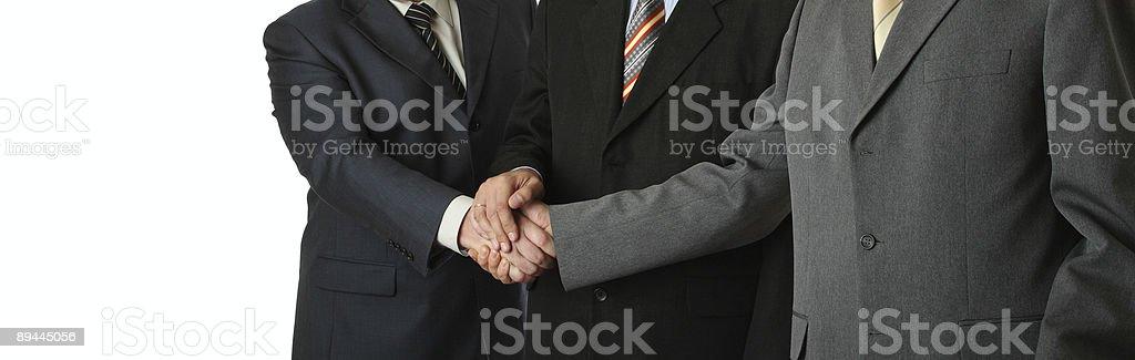 Three man, handshake royalty-free stock photo