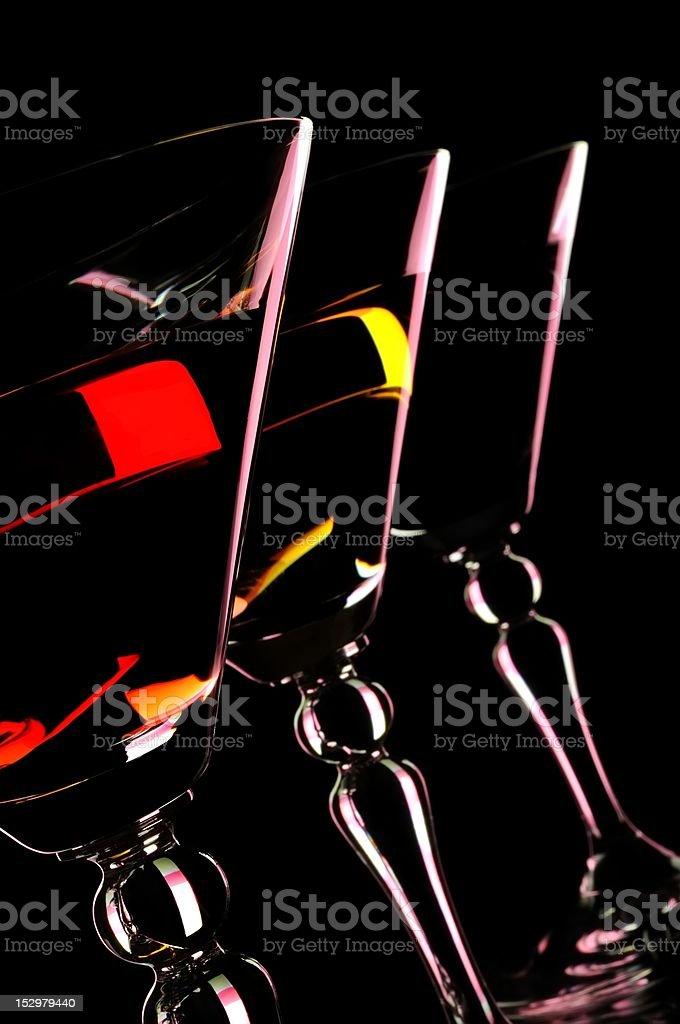 Three martini glasses at the black background. stock photo