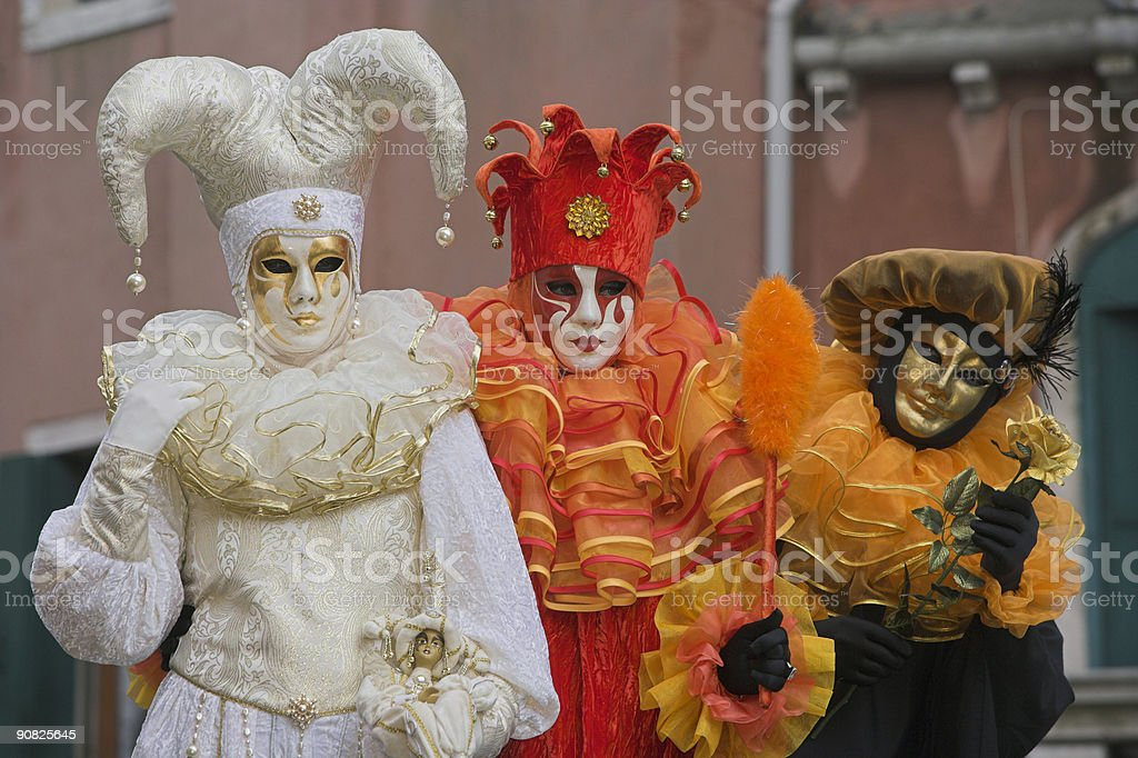 Three masks with colorful costumes at carnival in Venice (XXL) royalty-free stock photo
