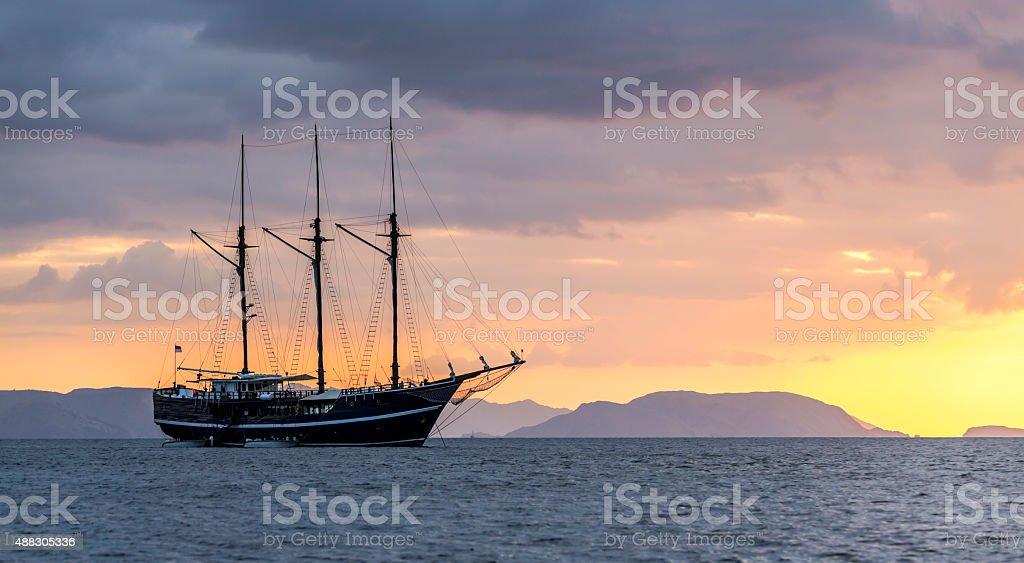 Three mast luxury yacht in Komodo National Park in Indonesia stock photo