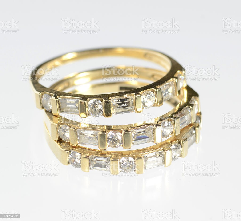 Three Matching Diamond and Yellow Gold Rings royalty-free stock photo
