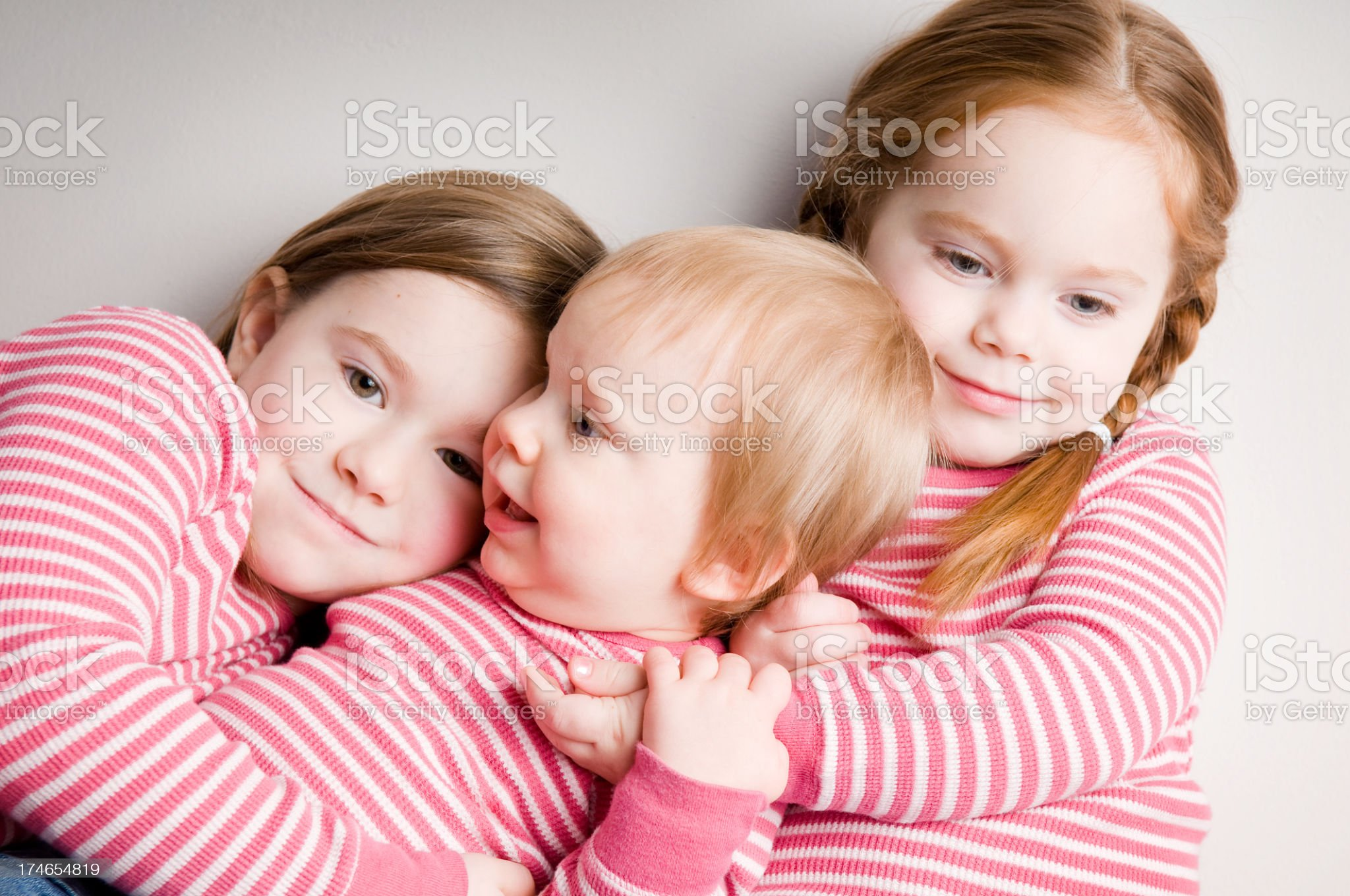 Three Matching Sisters Hugging Each Other royalty-free stock photo