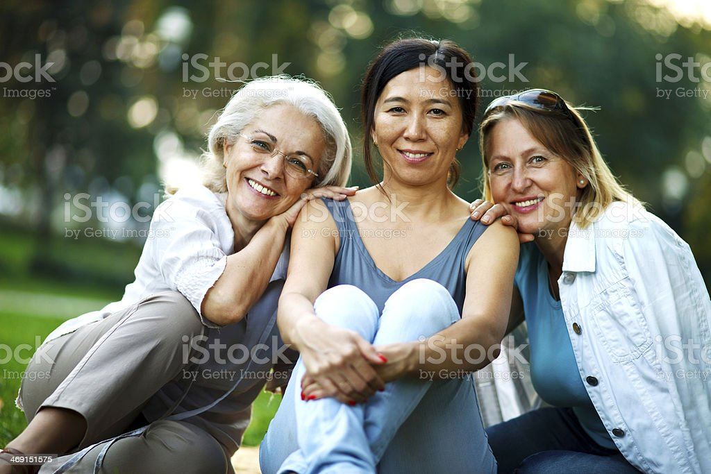 Three mature ladies smiling stock photo