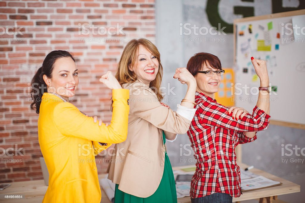 Three mature woman working in office. stock photo