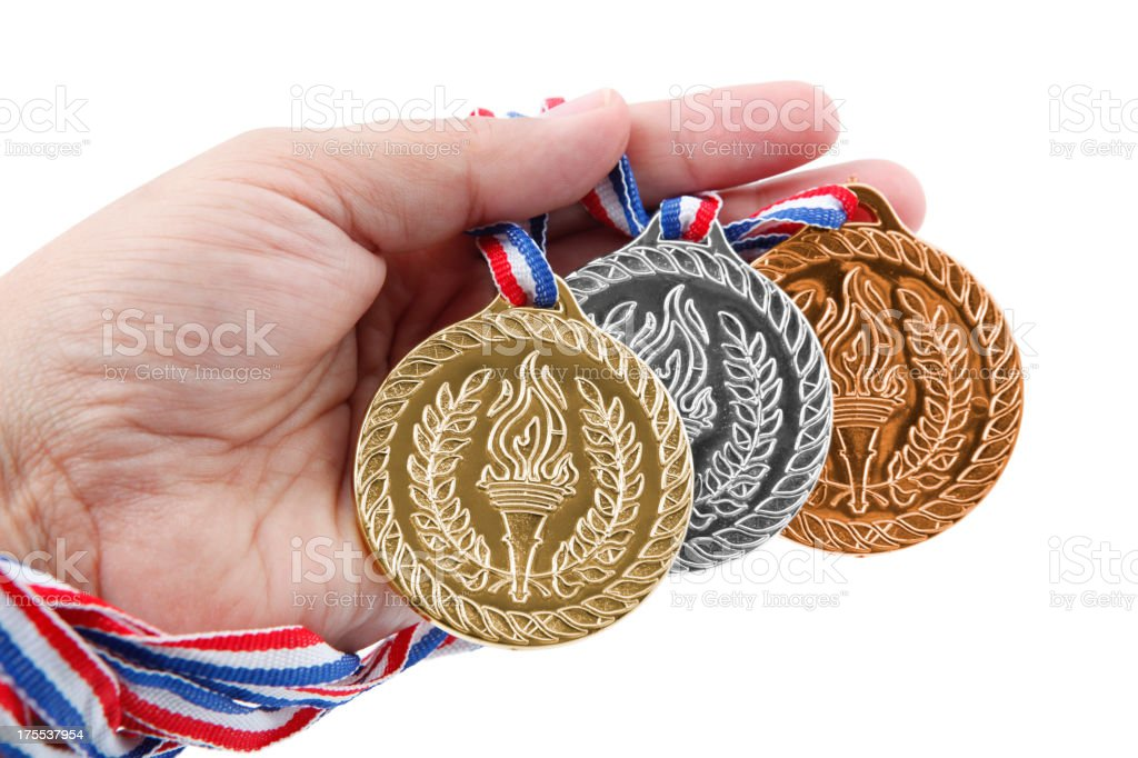 Three medals in hand royalty-free stock photo