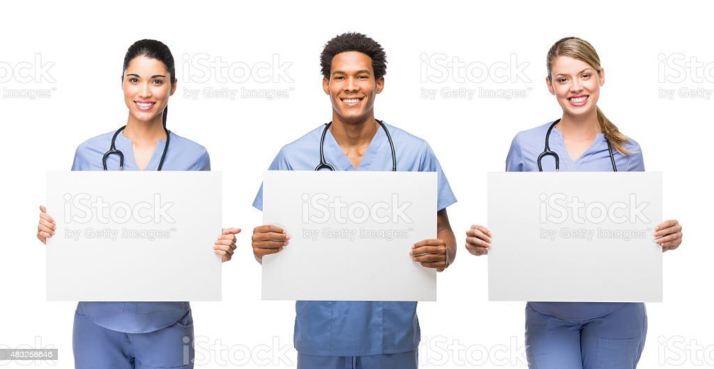Three medical professionals holding banners stock photo