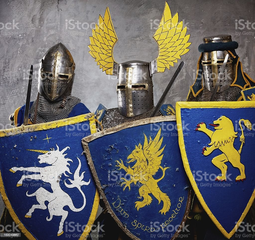 Three medieval knights  on grey background. stock photo