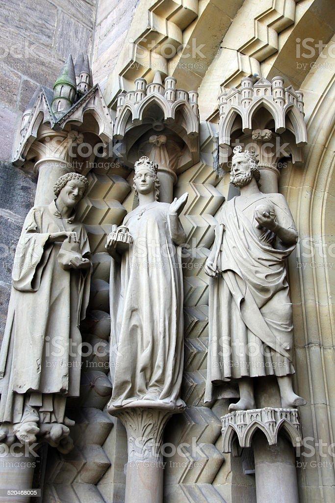 three medieval sculptures stock photo