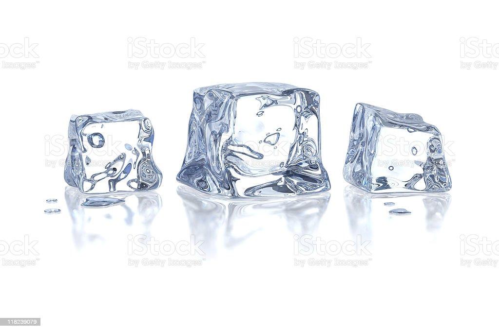 Three melting ice cubes isolated on white stock photo