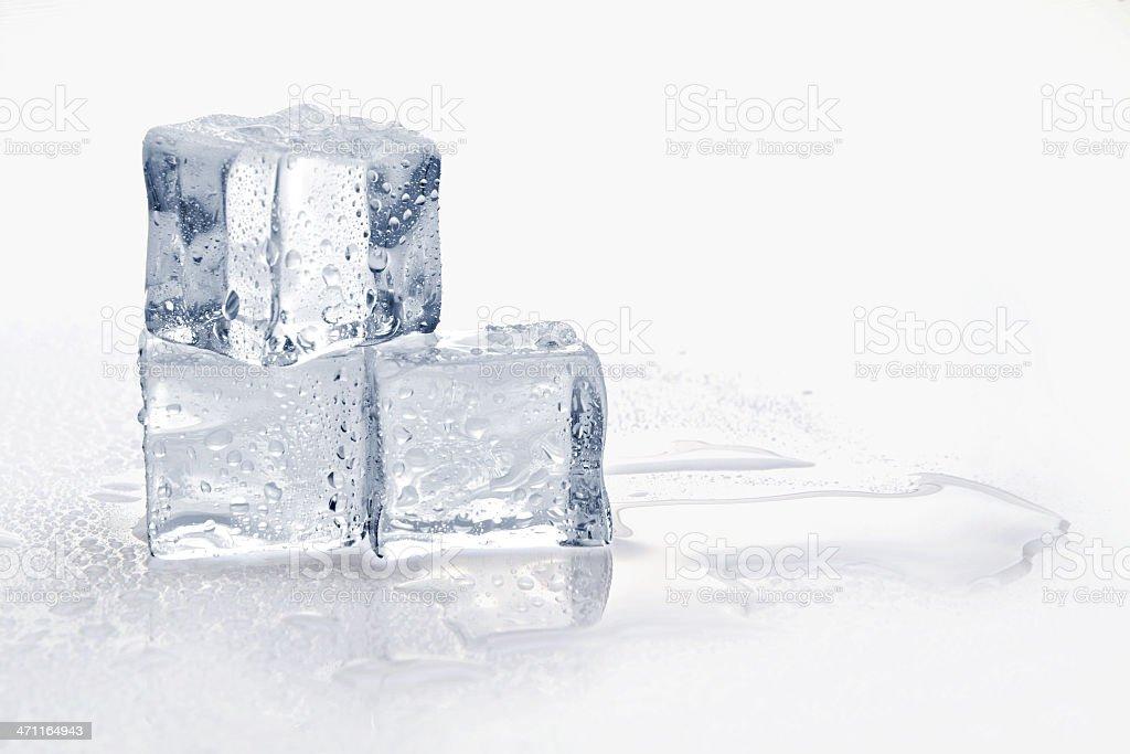 Three melting ice cubes on white background stock photo