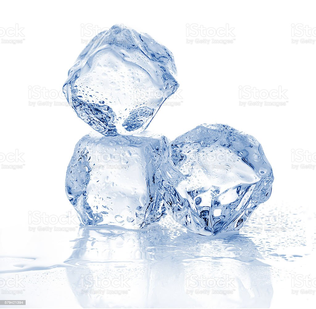 Three melting ice cubes on white background. stock photo