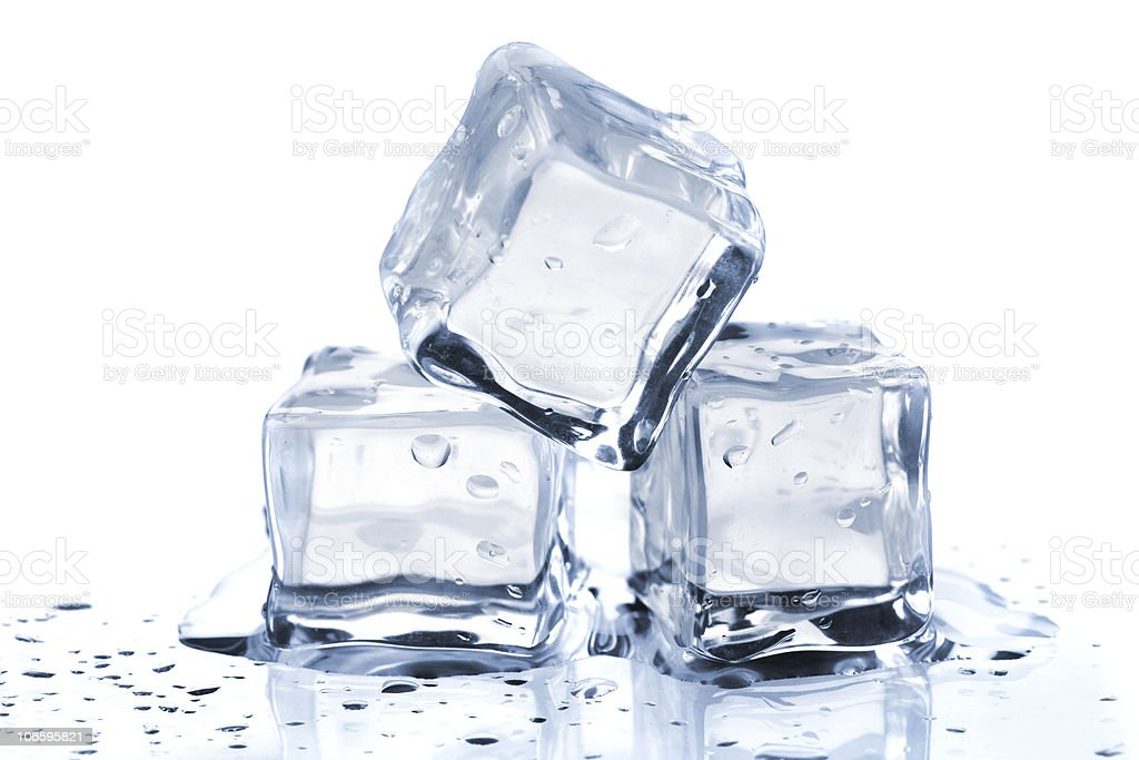 Three melting ice cubes stock photo
