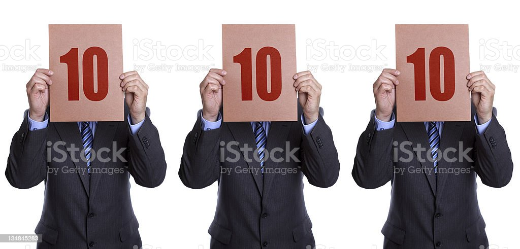 Three men all holding signs with 10 in front of their faces stock photo