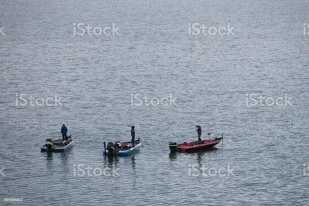 three men are fishing at Kawaguchiko lake, Japan stock photo