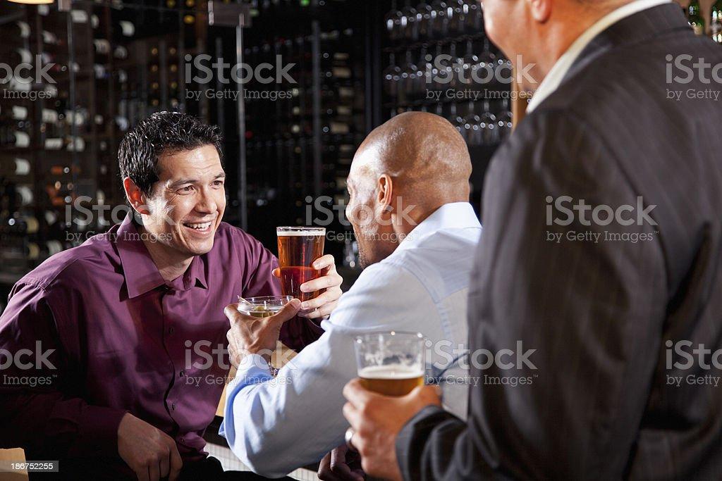 Three men at bar after work royalty-free stock photo