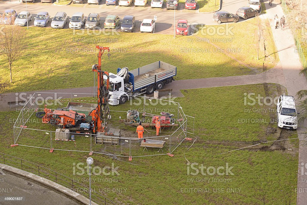 Three Men Drilling Borehole with Mobile Rig stock photo