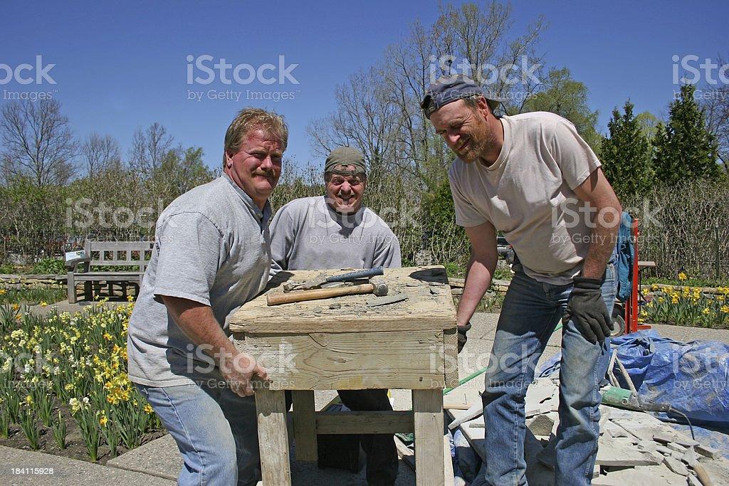 Three Men Heavy Lifting royalty-free stock photo