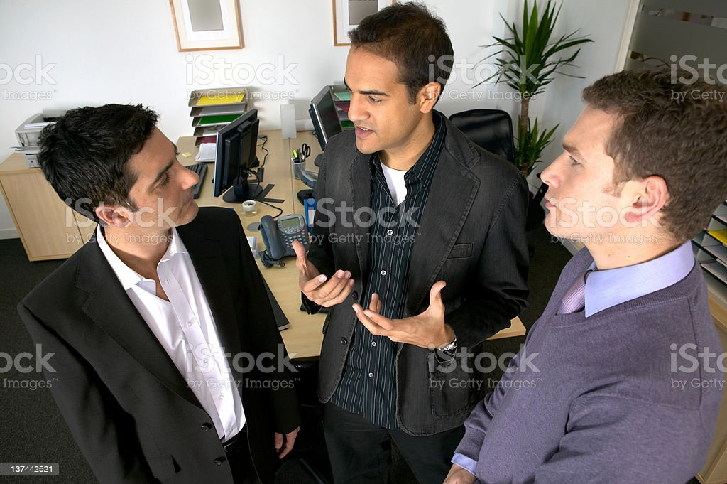 Three men in discussion royalty-free stock photo
