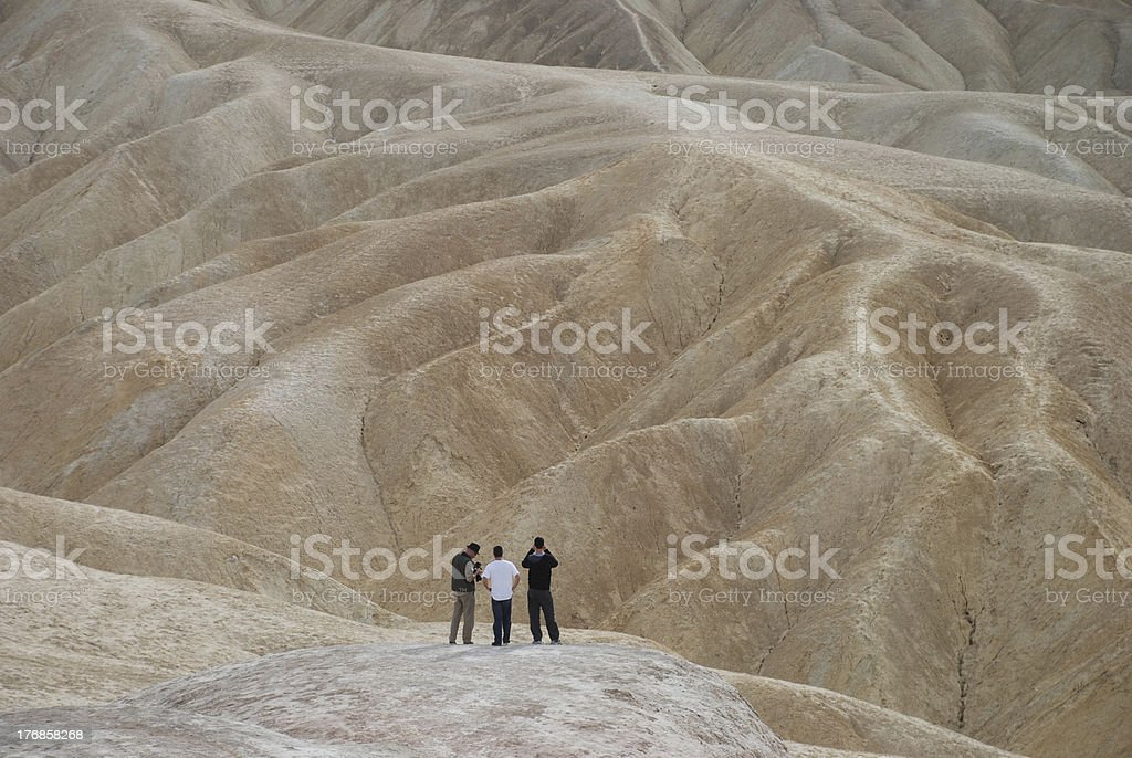 Three Men in the Desert royalty-free stock photo