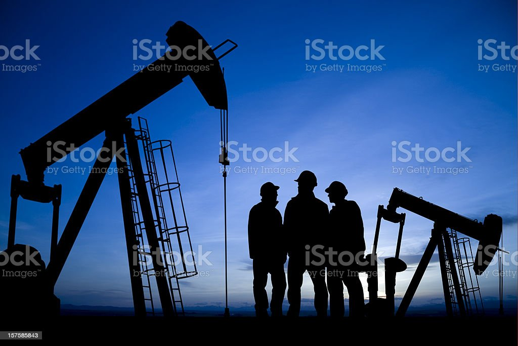 Three Men Meet in an Oilfield royalty-free stock photo