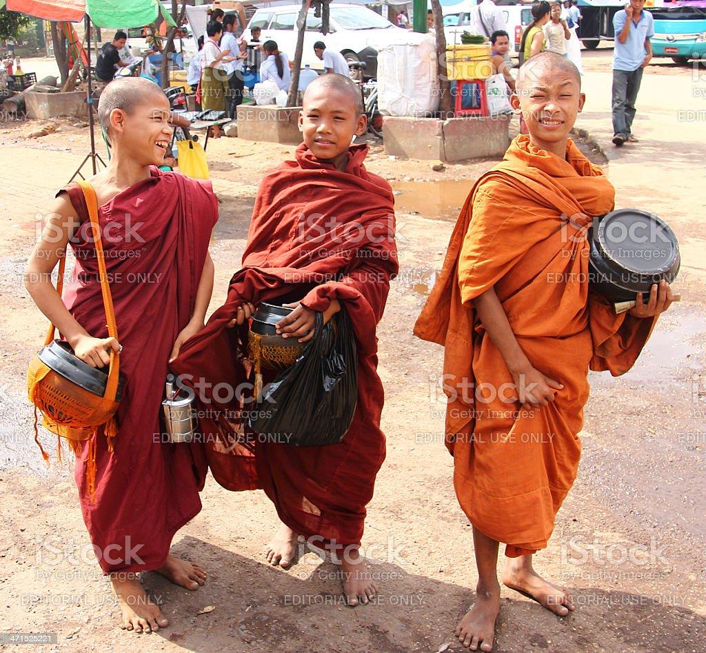 Three mendicant monchs stock photo