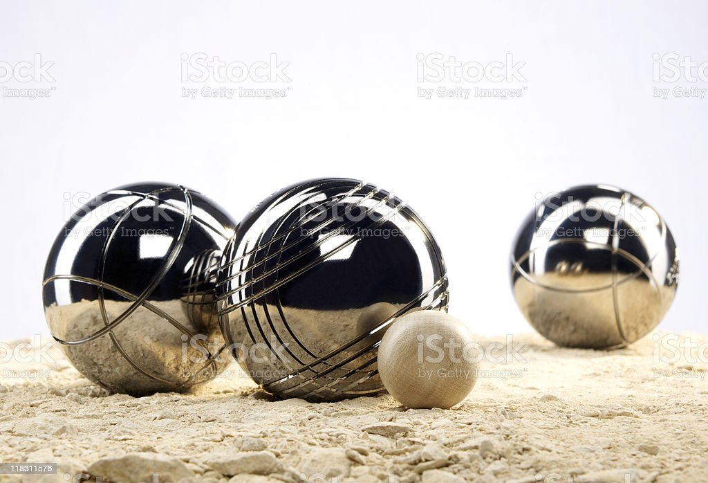 Three metal balls and one  wooden ball stock photo