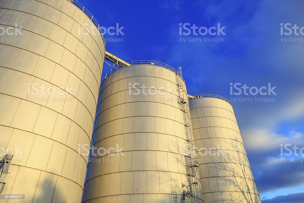 Three metal silos stock photo