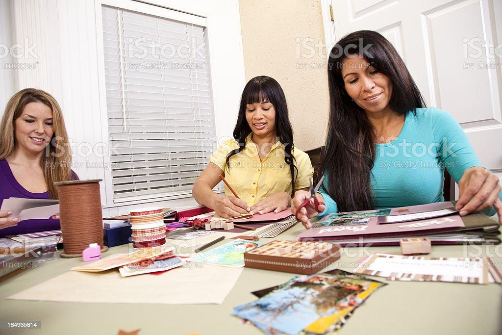 Three mid-adult multi-ethnic ladies scrapbooking royalty-free stock photo