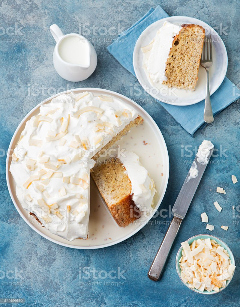 Three milk cake, tres leches cake with coconut. Top view stock photo