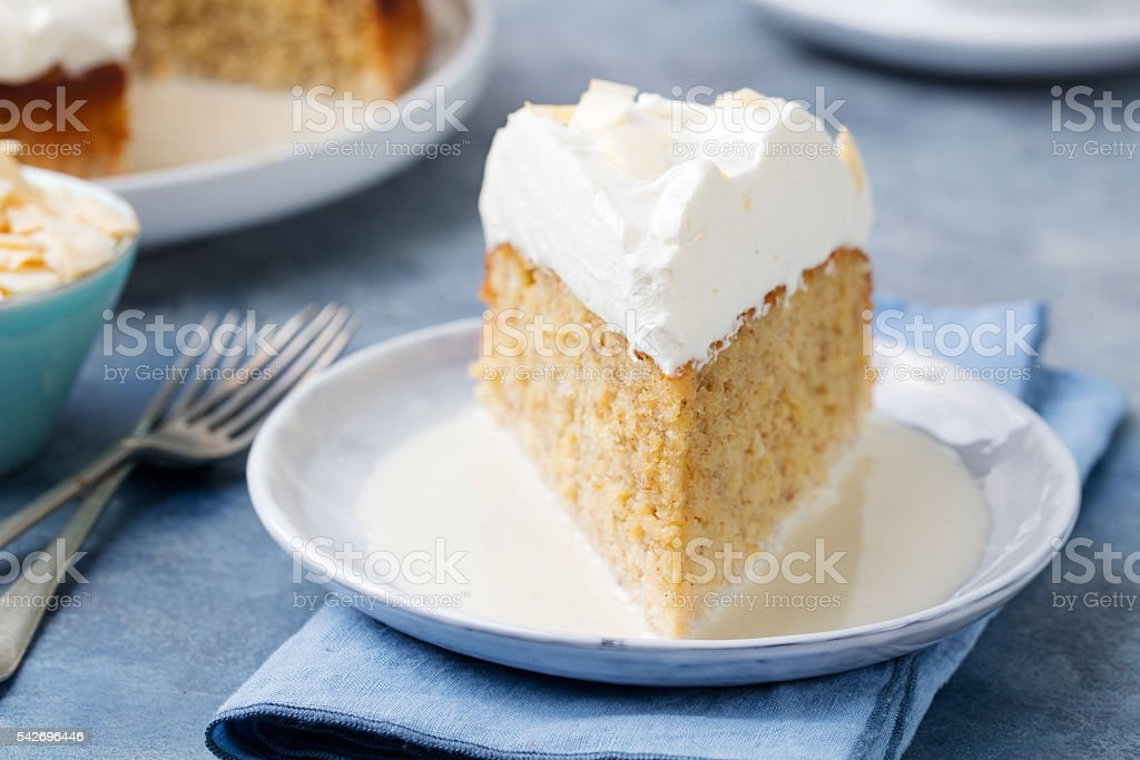 Three milk cake, tres leches cake with coconut. Traditional dessert...