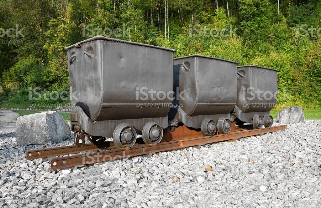 Three mine carts stock photo