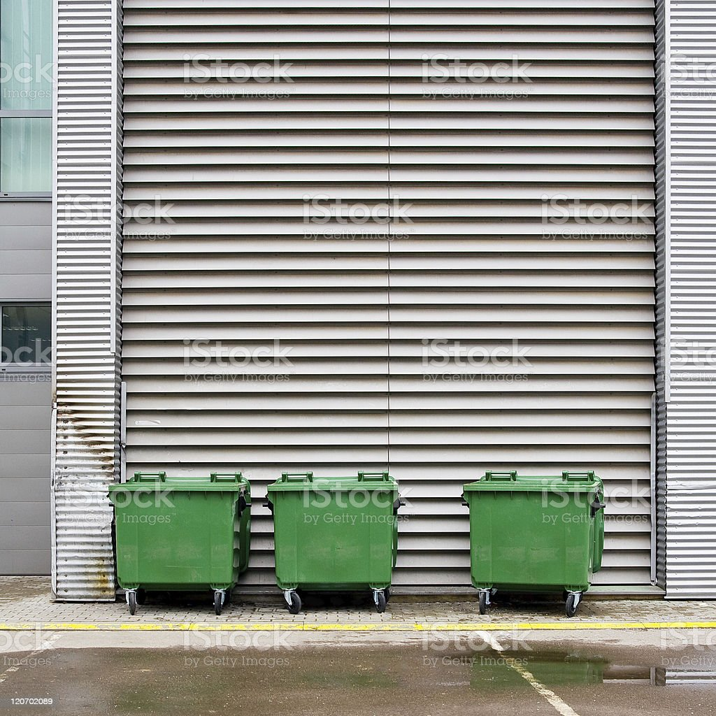 Three misaligned green dumpsters stock photo