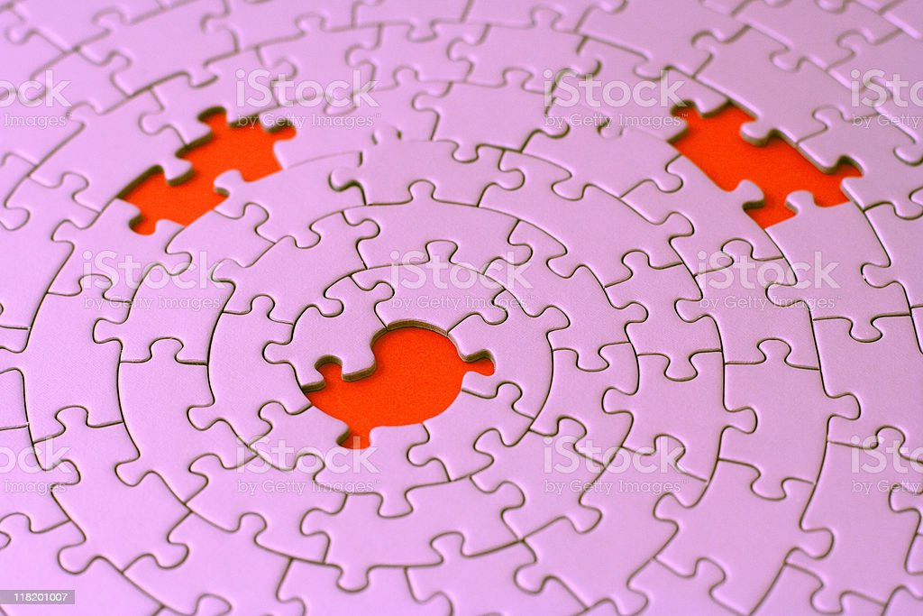 three missing pieces in a pink jigsaw royalty-free stock photo