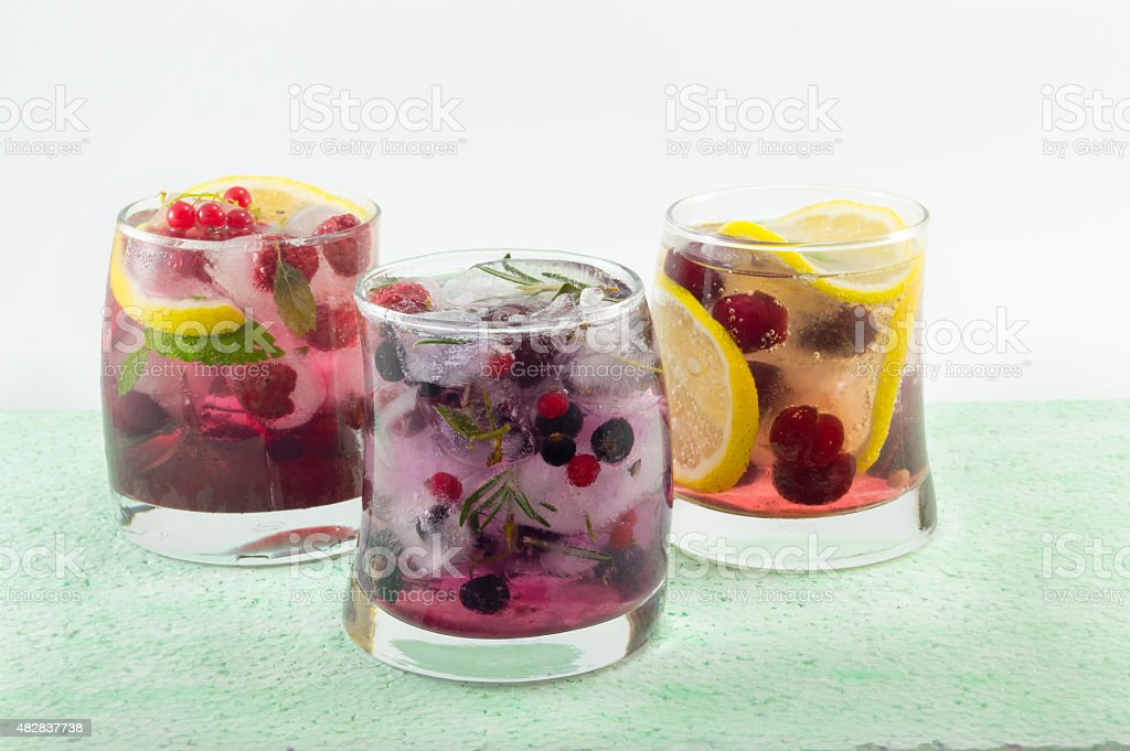 Three mixed fruit iced teas . Cold summer beverage stock photo