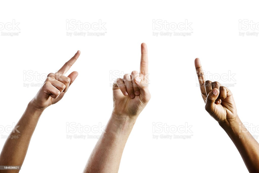 Three mixed hands point upward towards same unseen object stock photo