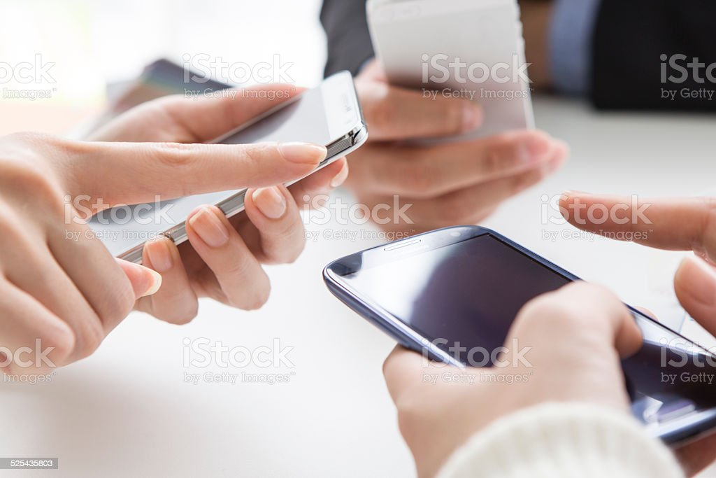 Three mobile phone in communication stock photo