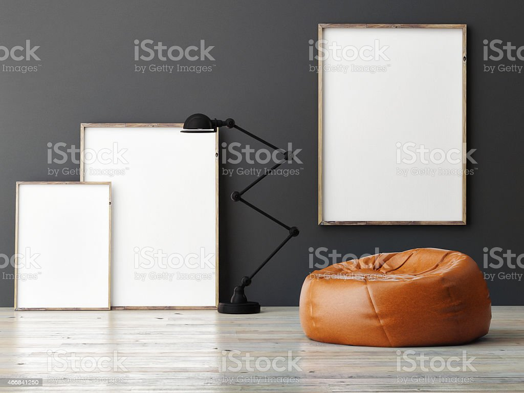 three mock up posters on grey wall stock photo