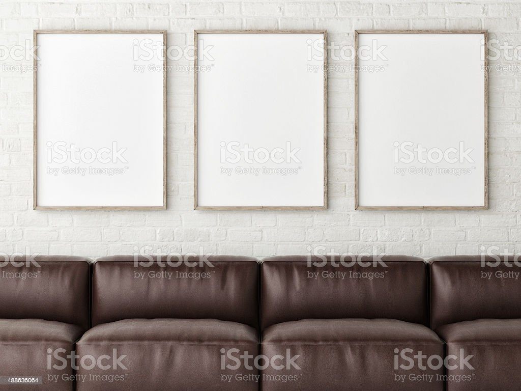 Three mock up white posters with brown leather sofa stock photo