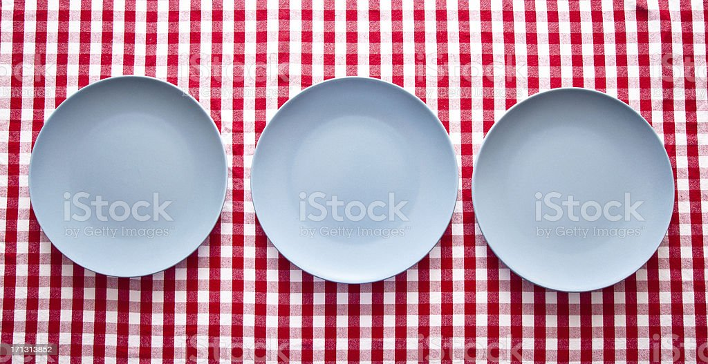three modern blue plates on french red checkered tablecloth royalty-free stock photo