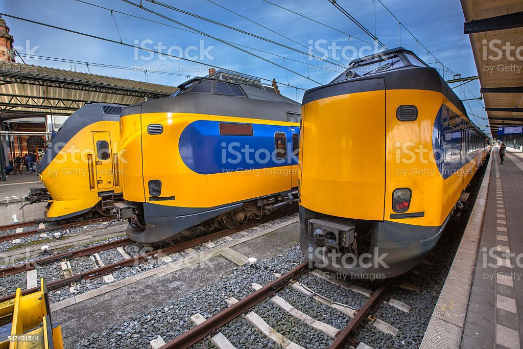 Three modern passenger commuter trains waiting at a historic sta stock photo