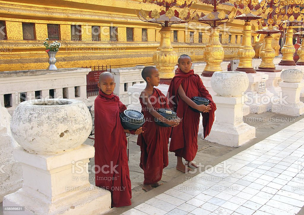 three monks in Shwezigon Pagoda royalty-free stock photo