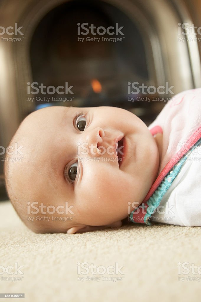 Three month old baby on carpet royalty-free stock photo