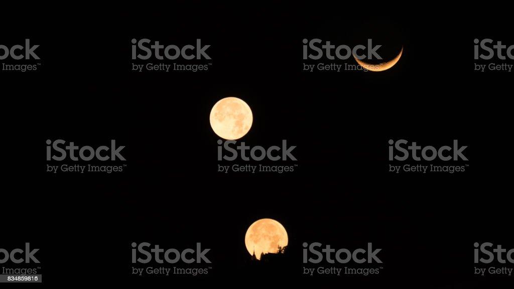 three moonset at buddhism pagoda temple stock photo
