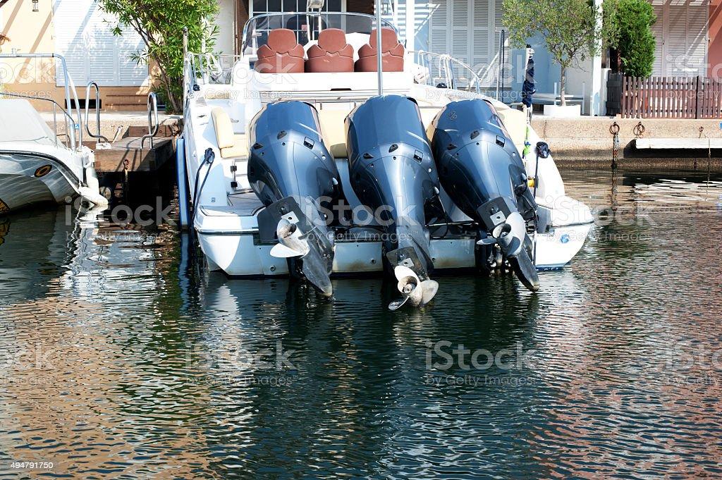 Three motors for the speed boat stock photo