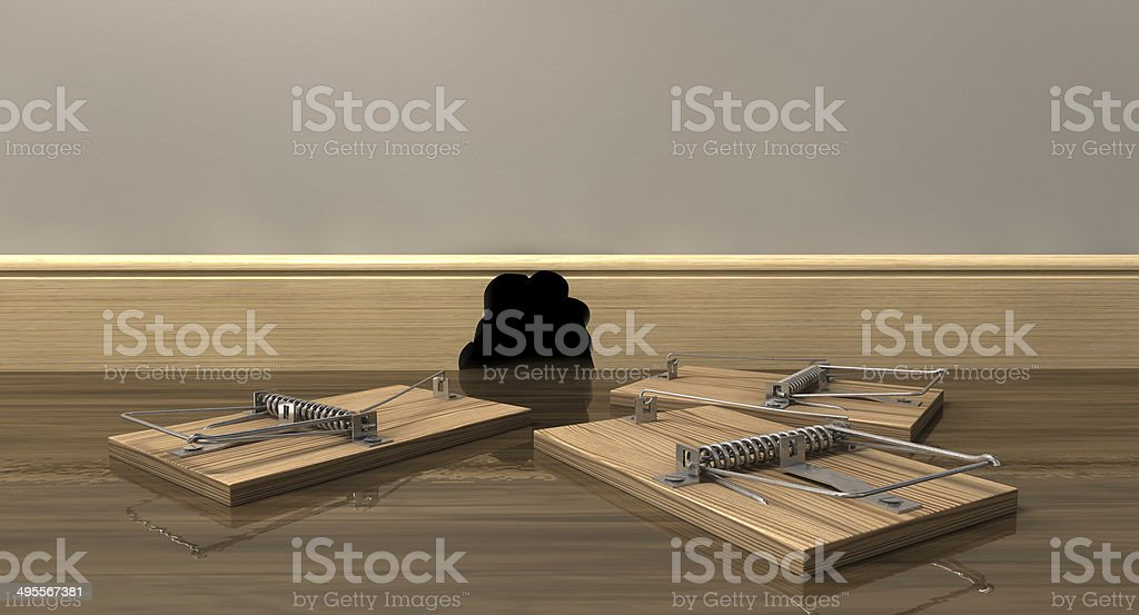 Three Mousetraps Outside A Hole stock photo