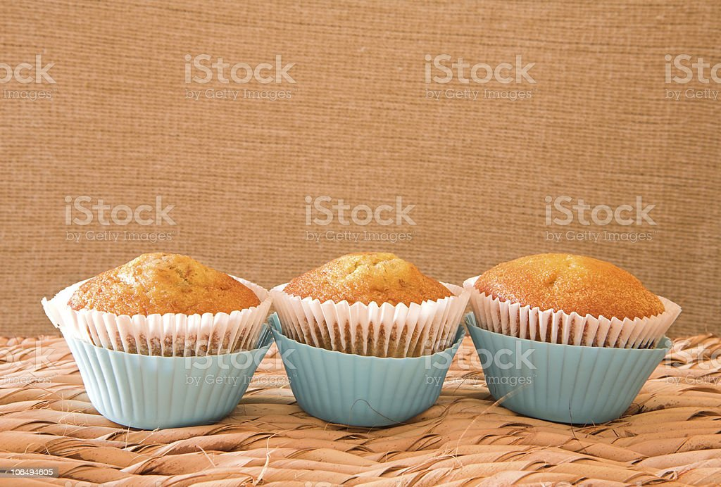Three muffins in blue cups royalty-free stock photo
