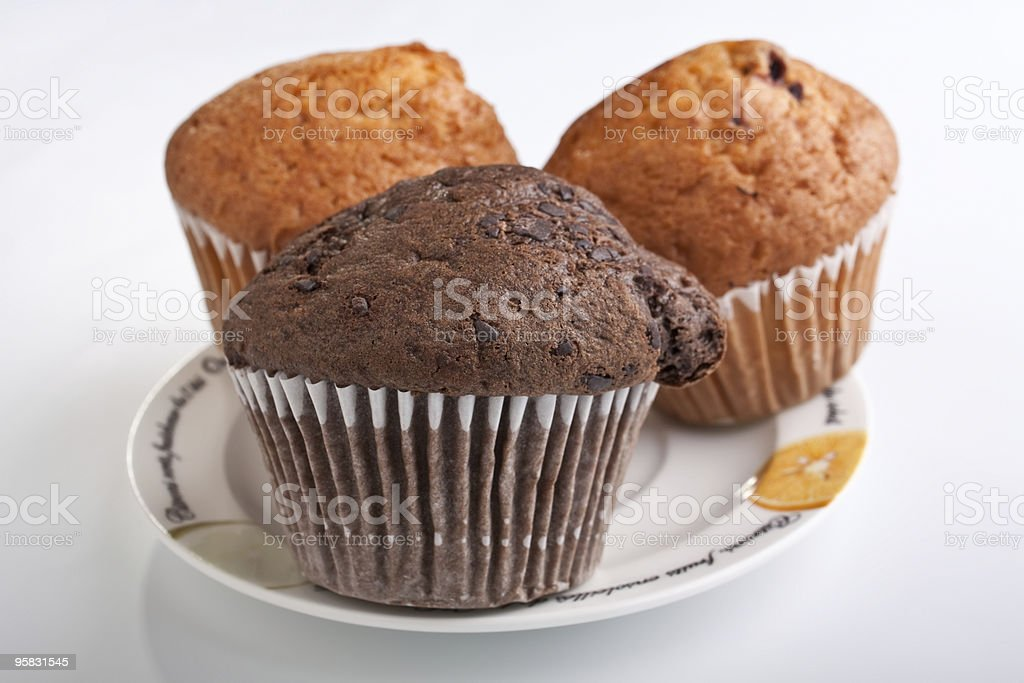 three muffins on a plate royalty-free stock photo