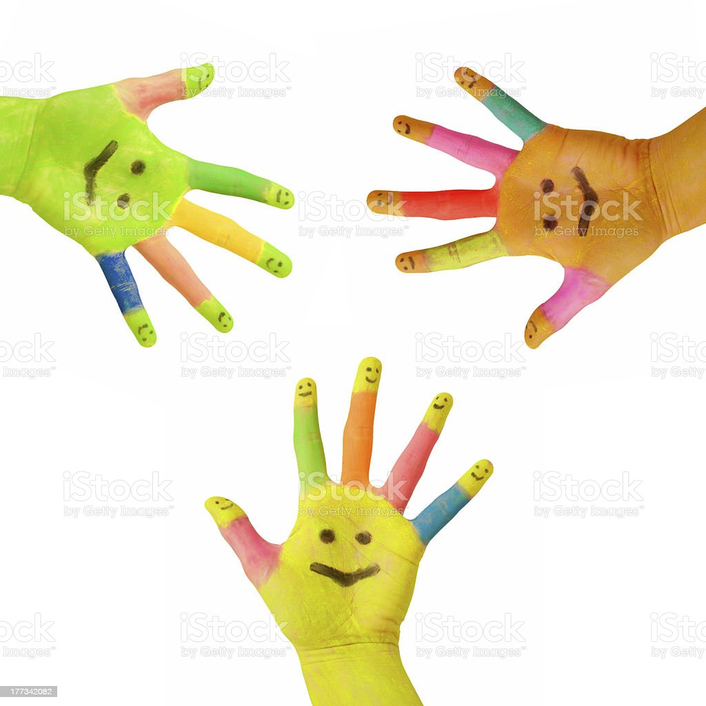 Three multi-colored hands smiling stock photo