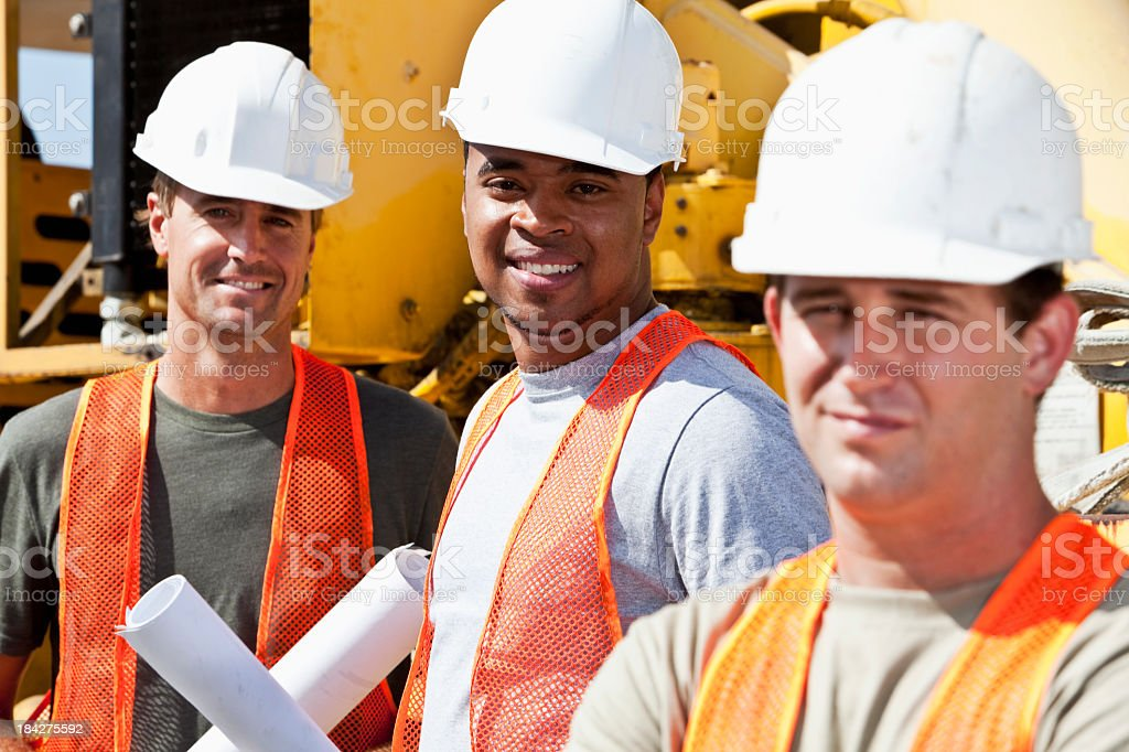 Three multi-ethnic construction workers stock photo